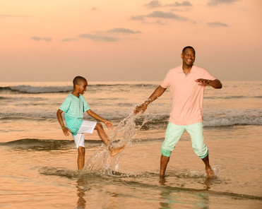 Father-son photo on Playa Langosta, Guanacaste, Costa Rica