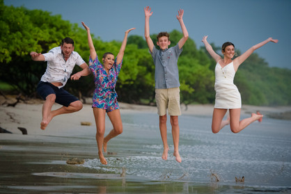 Family photos on Langosta Beach in Tamarindo, Costa Rica