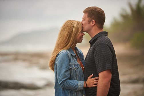 Surprise proposal photography on Playa Langosta in Tamarindo, Costa RIca