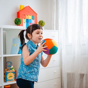 children little girl play in a children'