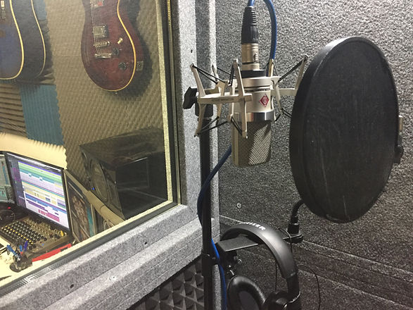 Recording vocals in studio with Neumann TLM 102 microphone
