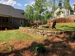 Retaining wall and sod installation