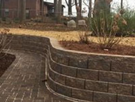 Retaining wall curved around the side of the house