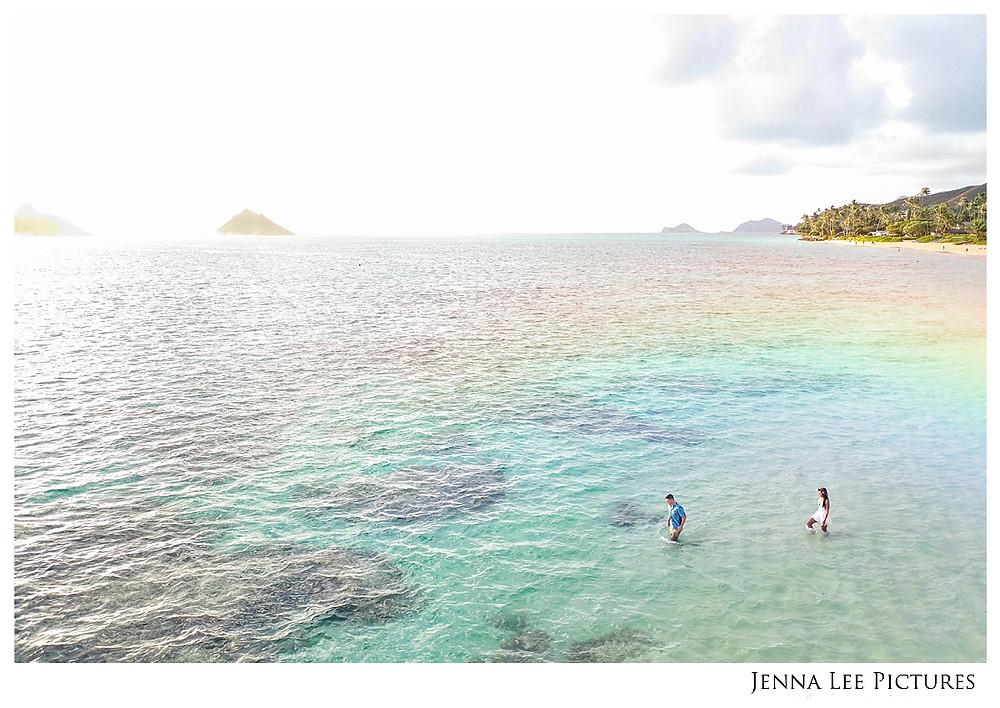 A rainbow sparkles over the hawaiian ocean