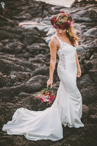 The lava bride holds her flowers from Grace Flowers after hiking miles out to witness the creation of new earth.