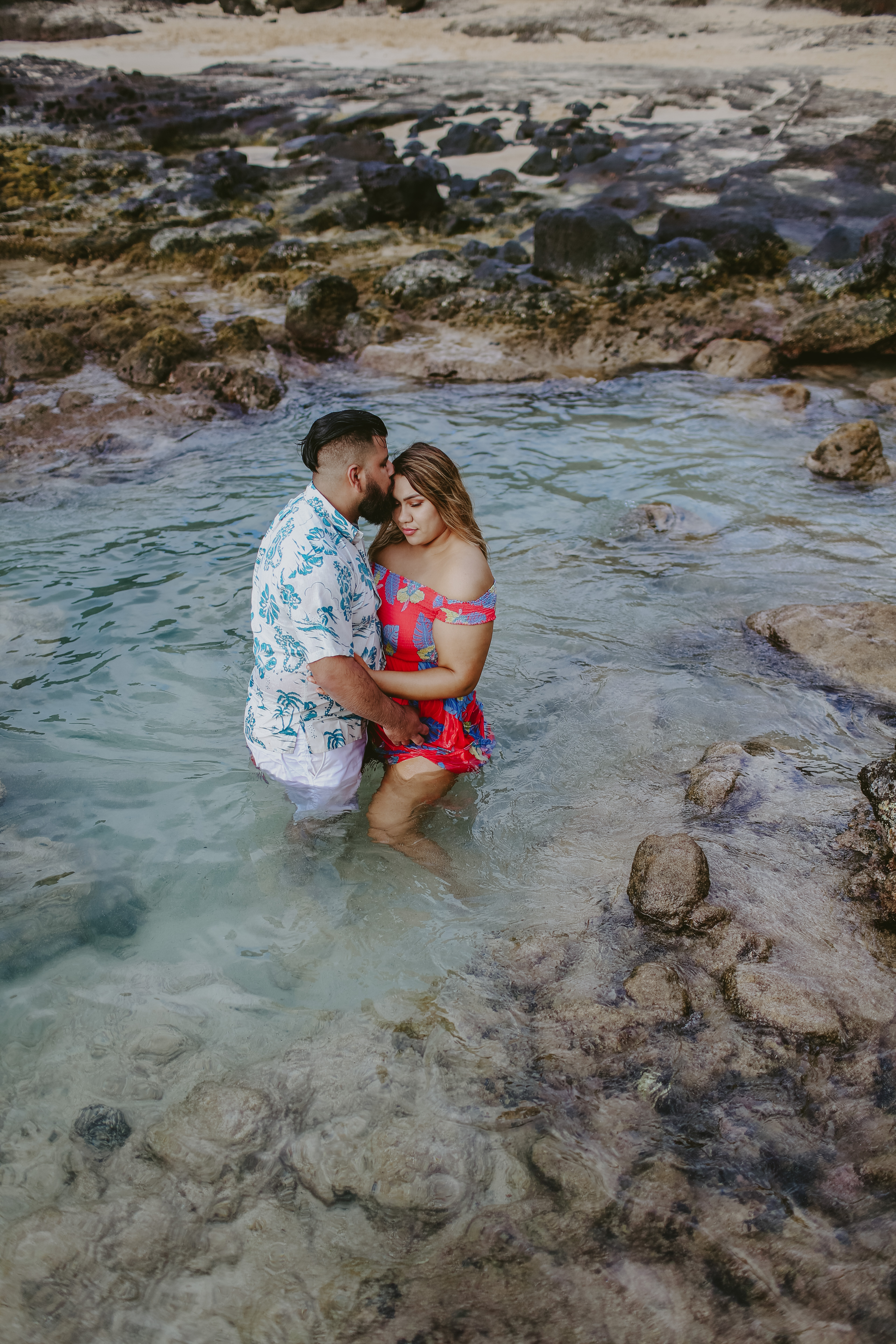 Adventure wedding photographer couple in a tide pool