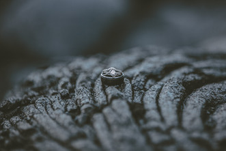 A couples wedding bands resting on some hardened lava on the big island of Hawaii