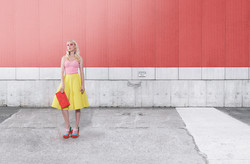 Fashion Model on red Wall