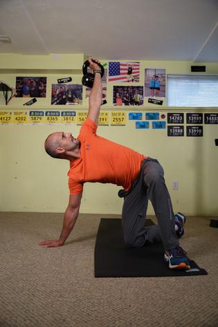 Coach Slava perfecting  The Turkish Get Ups