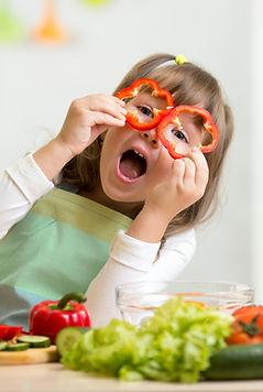 kid girl having fun with food vegetables