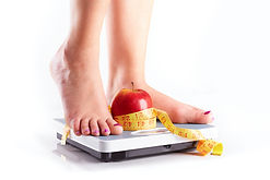 Weight-loss-scale-apple-and-measuring-ta