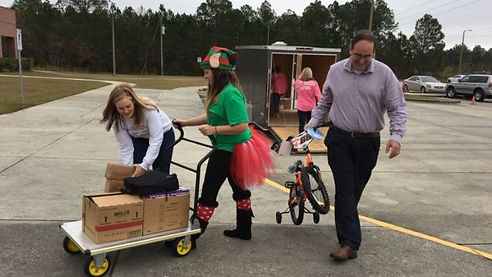 Volunteers help bring Christmas Presents into the Harrison County DHS Office.