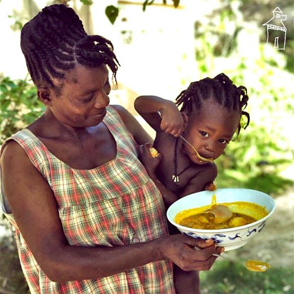 Zaza and her youngest son Kwa enjoying soup joumou in Matènwa.