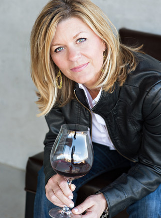 Maria head shot with Pinot in hand_2013.