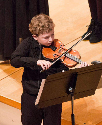 Young violinist performs at the Kauffman Center's Future Stages Festival with the Metropolitan Conservatory Youth Orchestra in 2017.
