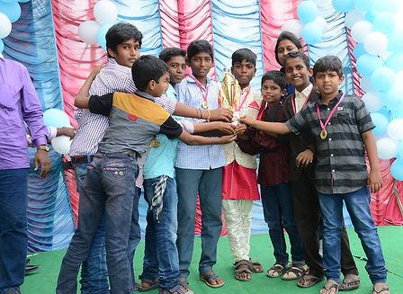 boys with trophy.jpg
