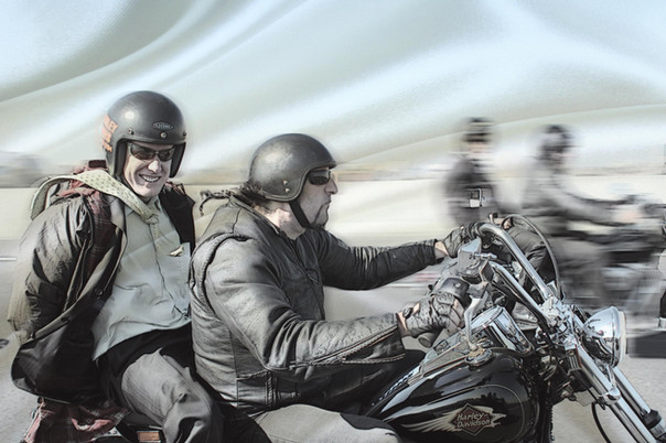 Riding on the back of a Harley Davidson