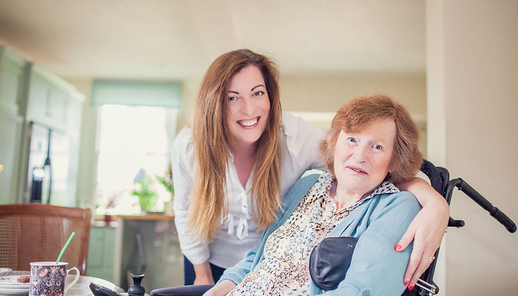 Woman in wheelchair with a live-in carer in her Hampshire home