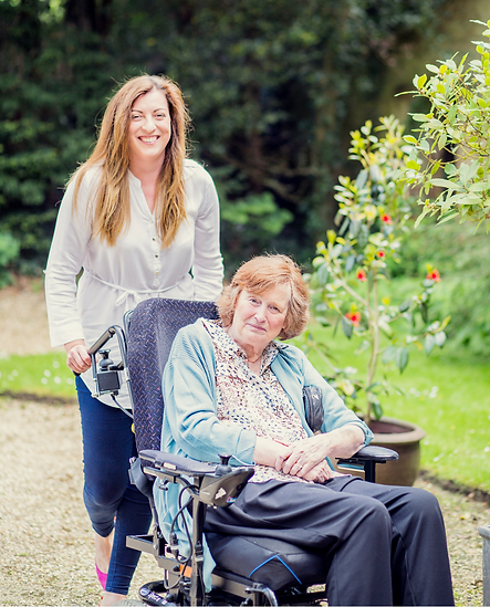 Live-in Carer with client in wheelchair in Wiltshire country garden