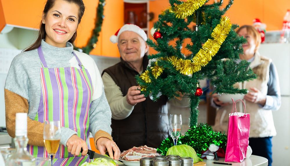 Live-in Carer Helping Elderly At Christmas