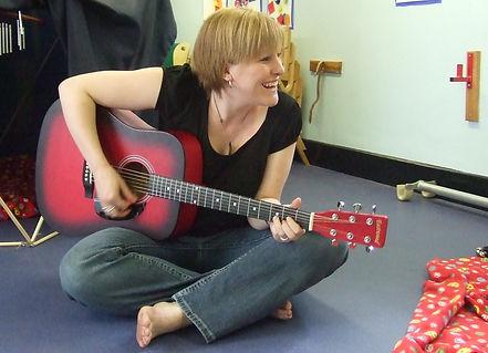 Me playing guitar cropped.jpg