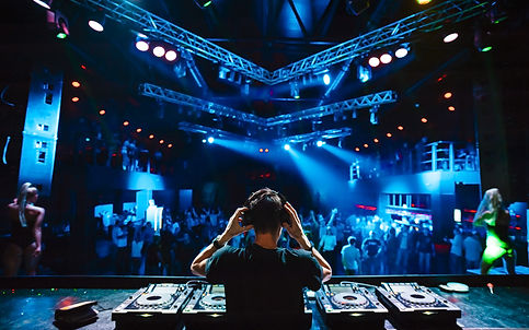 DJ with headphones at night club party u