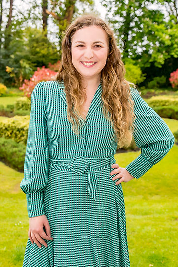 Yasmin Frampton stood outside with lawn and trees in the background