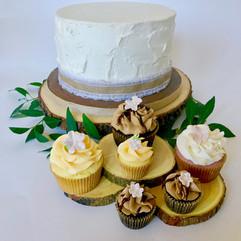 rustic-cutting-wedding-cake-cupcakes-dreamin-desserts.jpg