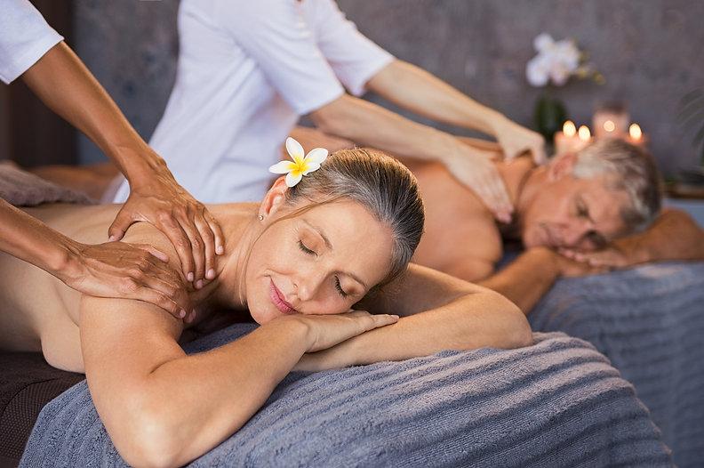 Senior couple in spa salon getting massa