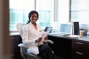 portrait-of-female-doctor-wearing-white-