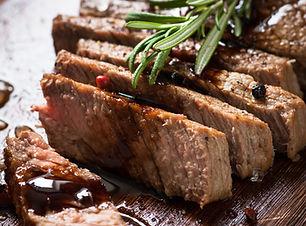 Sliced beef steak medium rare with balsa