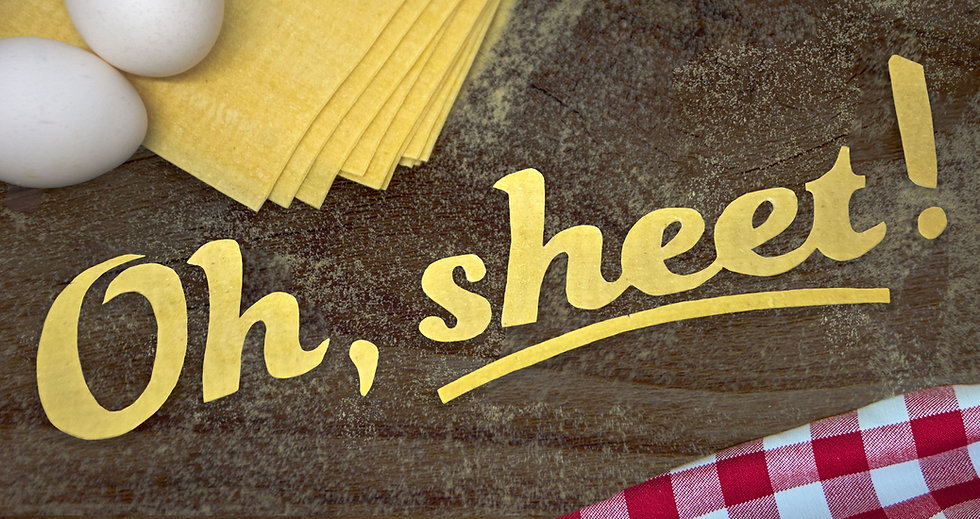 """food typography that says """"oh,sheet"""" cut out of pasta sheets"""