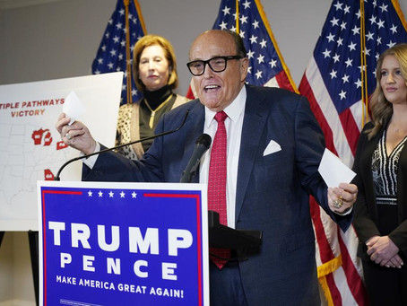 AP sources: Feds search Rudy Giuliani's NYC home, office