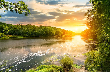 sunset-over-the-river-in-the-forest.jpg