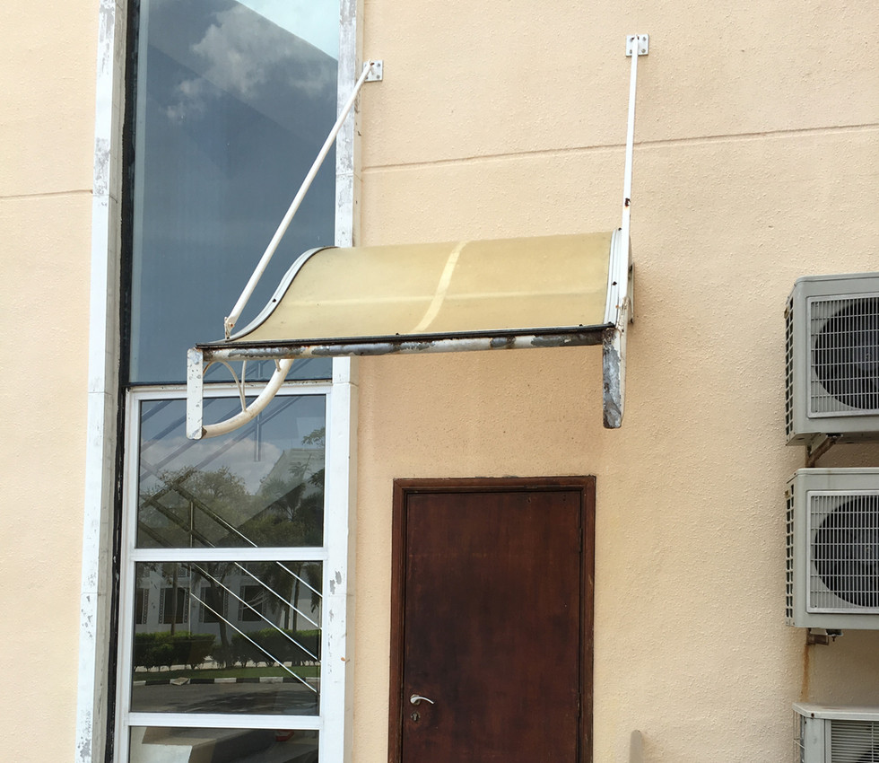 Uncoated Polyacrbonate Awning that Turned Yellow