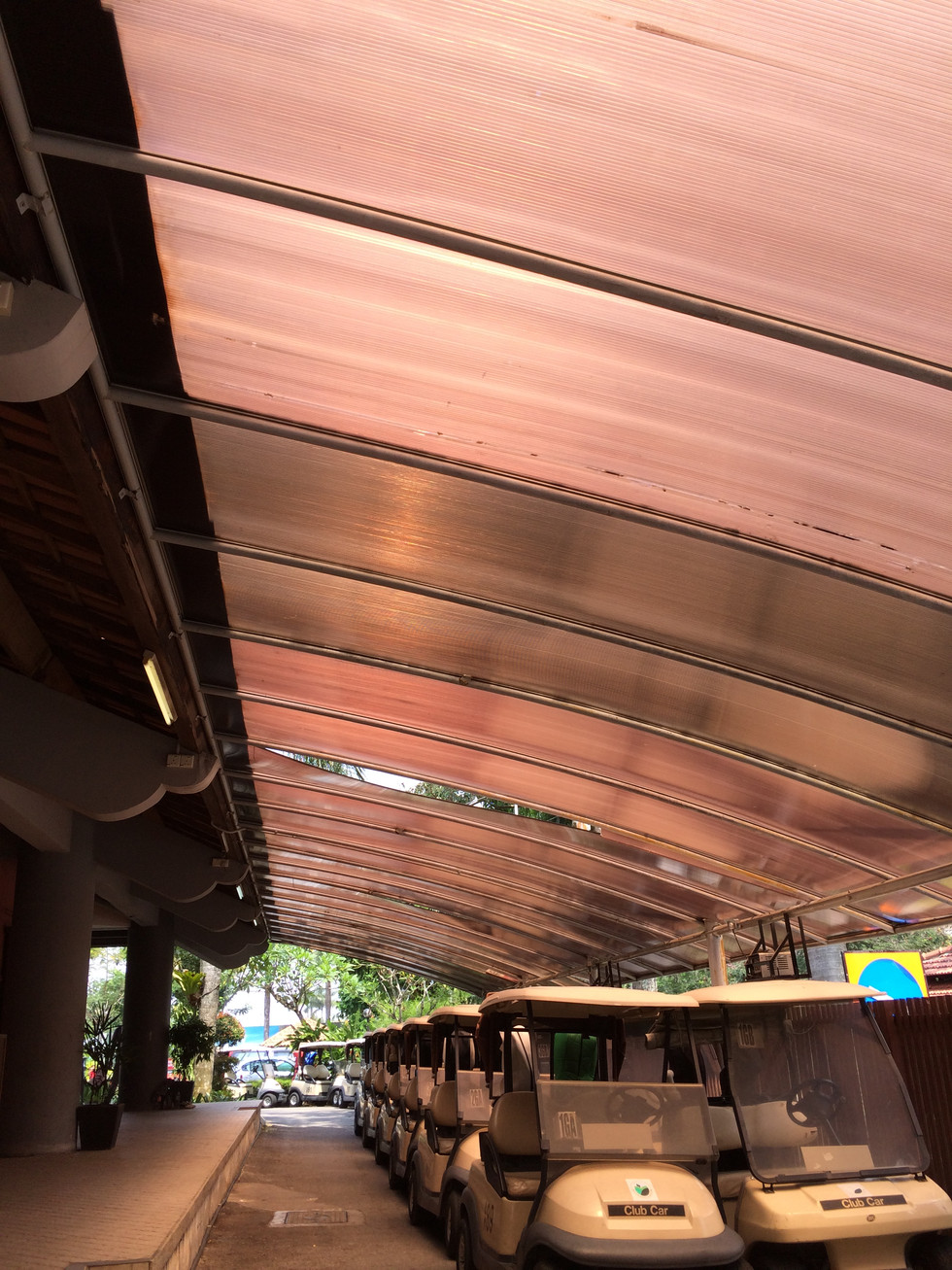 Uncoated Polycarbonate + Poor Workmanship in a Prestigious Golf Club Awning
