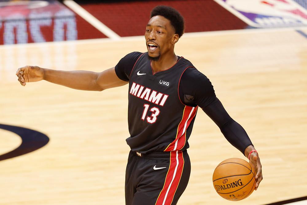 Miami Heat center Bam Adebayo calls out to his teammates during an NBA basketball game.