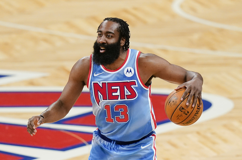 Brooklyn Nets point guard James Harden dribbles the basketball on offense during an NBA basketball game in Barclays Center in Brooklyn, New York.