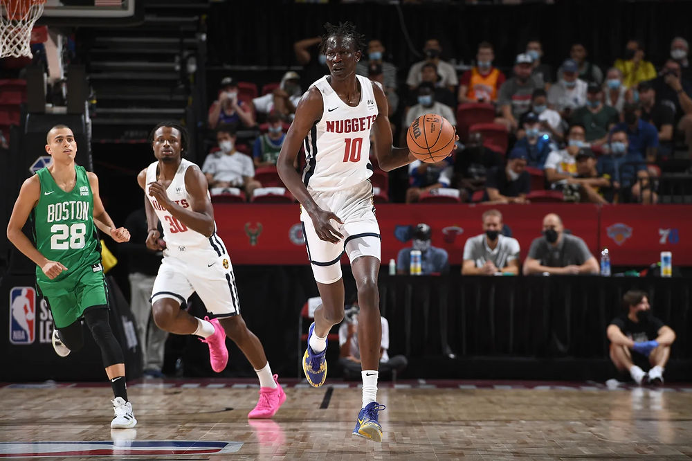 Denver Nuggets forward Bol Bol dribbles the ball up the court during an NBA Summer League game against the Boston Celtics on August 10, 2021.