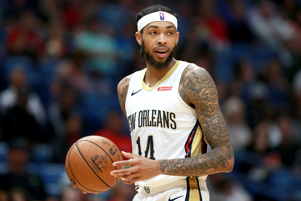 New Orleans Pelicans forward Brandon Ingram dribbles the ball up the court in an NBA basketball game.