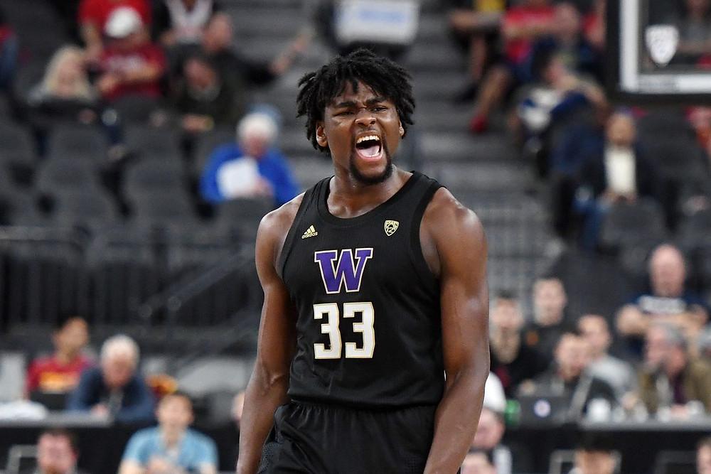 Washington center Isaiah Stewart celebrates a made basket in an NCAA basketball game.