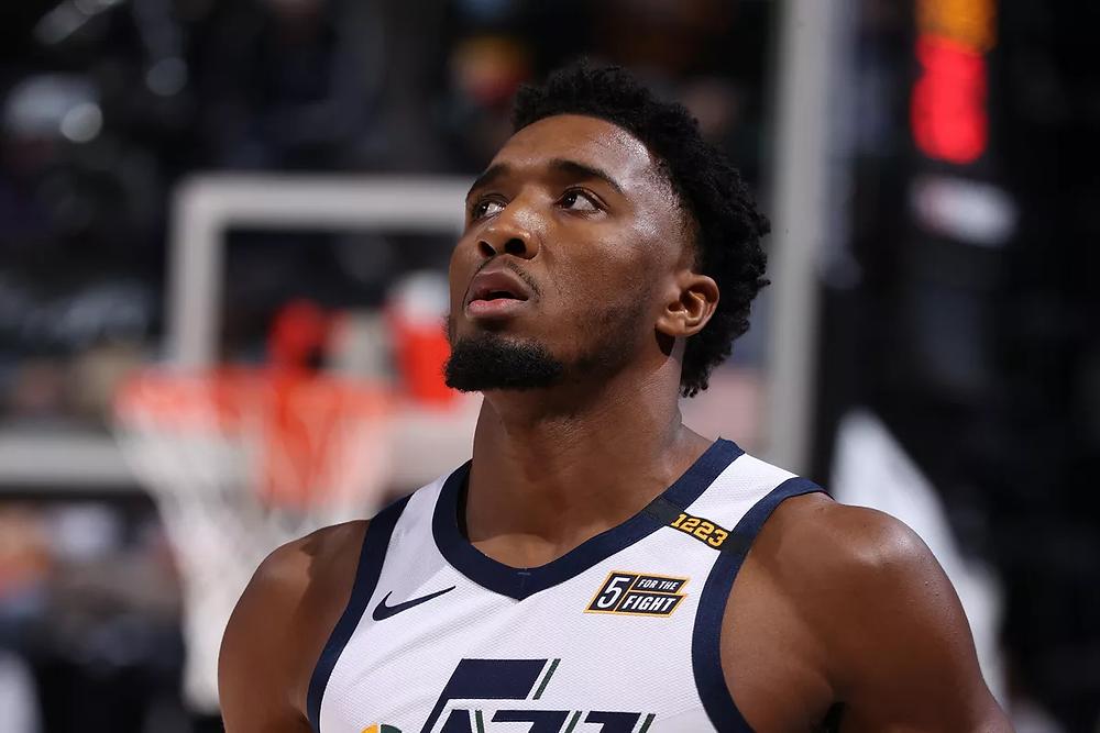 Utah Jazz guard Donovan Mitchell looks up towards the arena jumbotron during an NBA basketball game.