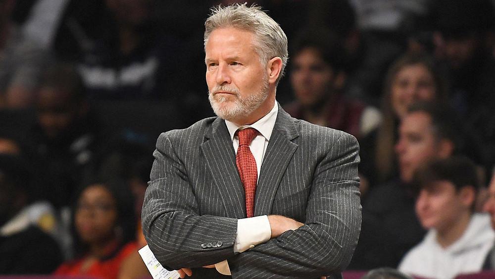 Philadelphia 76ers head coach Brett Brown looks at his team in an NBA basketball game.