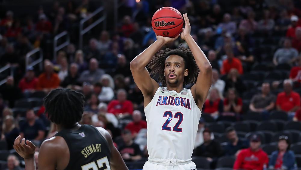 Arizona Wildcats forward Zeke Nnaji shoots a 3-pointer over center Isaiah Stewart in an NCAA basketball game against Washington.