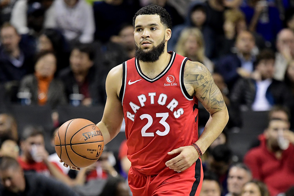 Toronto Raptors point guard Fred VanVleet dribbles the ball up the court in an NBA basketball game.