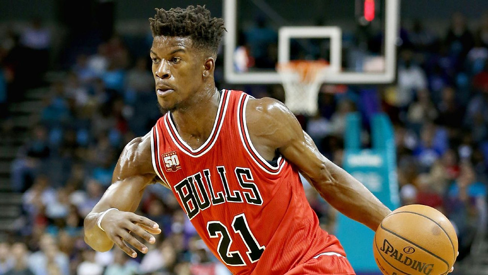 Chicago Bulls shooting guard Jimmy Butler drives the ball towards the basket in an NBA basketball game.