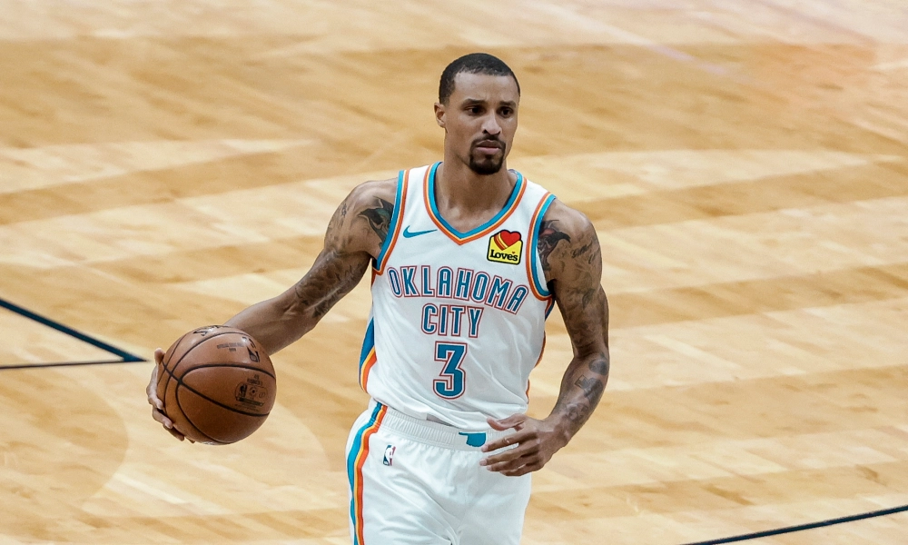 Oklahoma City Thunder point guard George Hill dribbles the ball up the court on offense during an NBA basketball game.