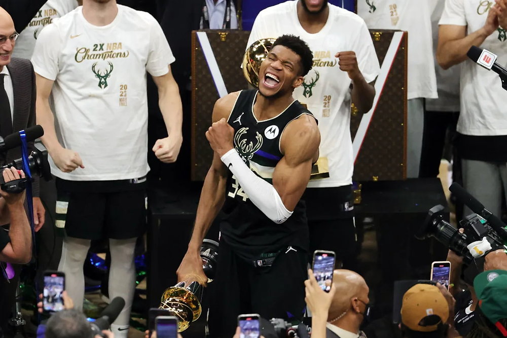 Milwaukee Bucks power forward Giannis Antetokounmpo celebrates his first championship victory on July 20, 2021.