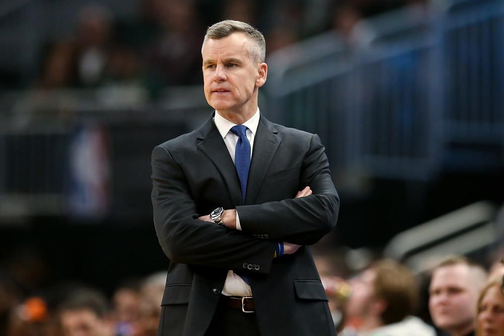Oklahoma City Thunder head coach Billy Donovan looks onto the court during an NBA basketball game.