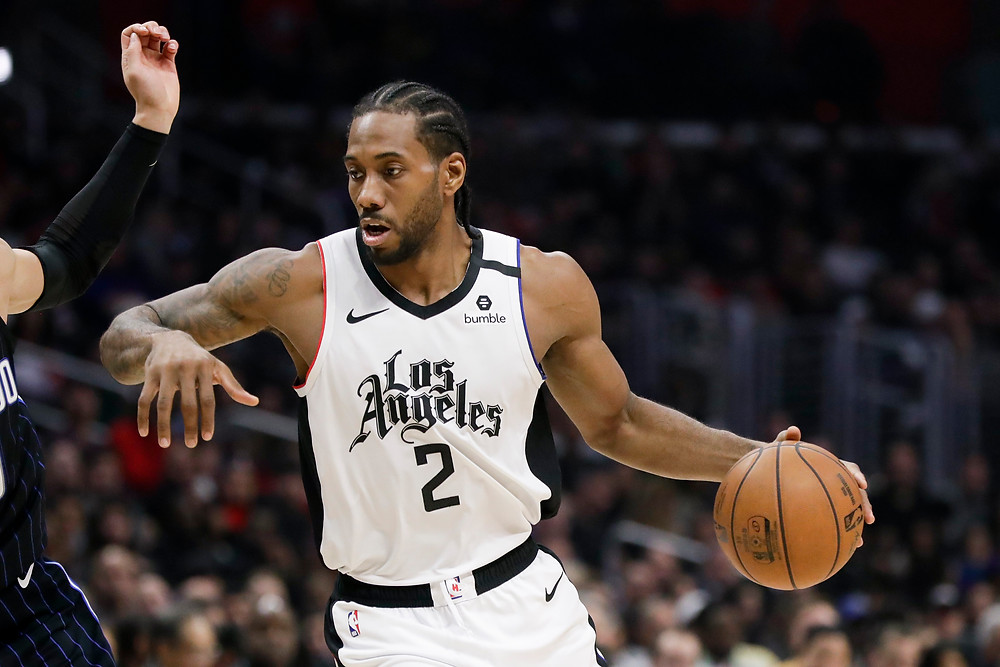 Kawhi Leonard of the Los Angeles Clippers dribbles the basketball against the Orlando Magic.